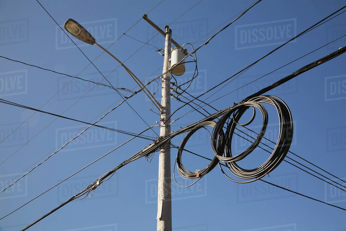 Utility Pole With A Street Lamp And Electrical Wires And Cables ...