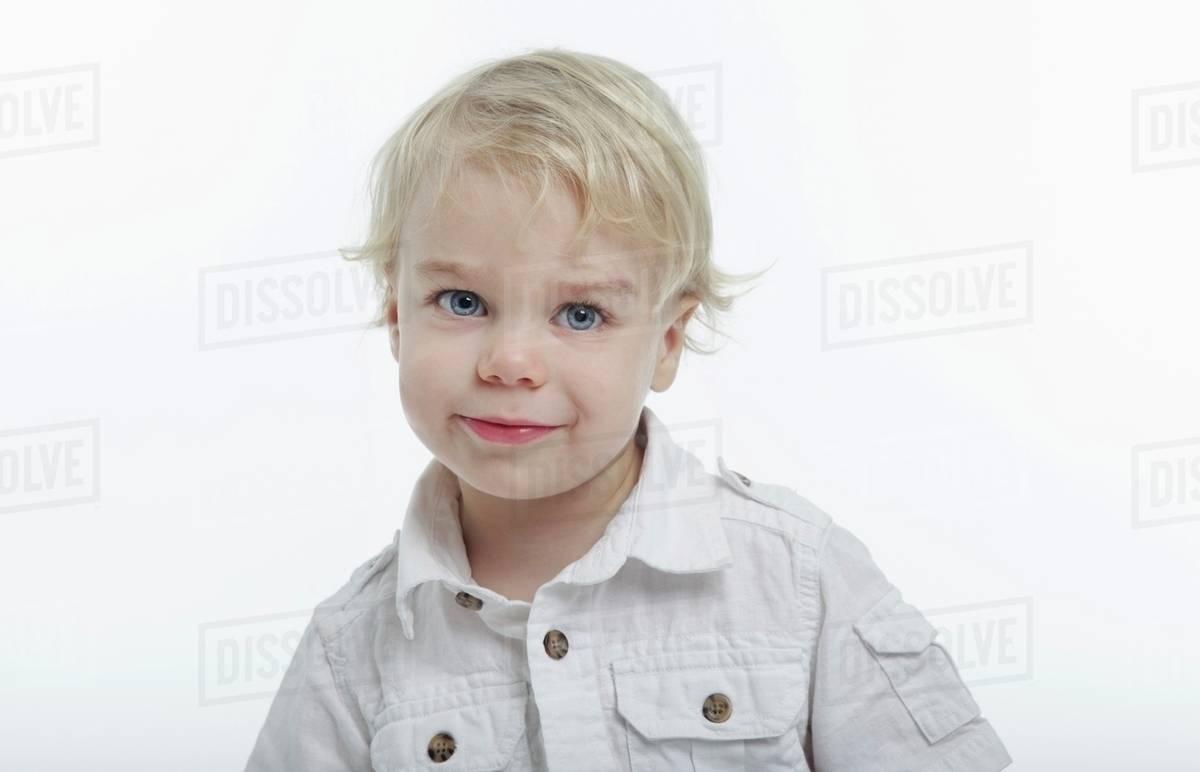 effe7d0196a5 Portrait Of Blonde Toddler Boy - Stock Photo - Dissolve
