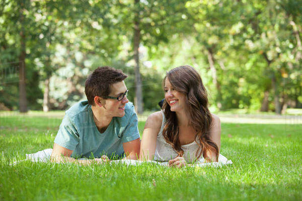 Newlywed Couple Spending Quality Time Together In A Park; Edmonton, Alberta, Canada Royalty-free stock photo