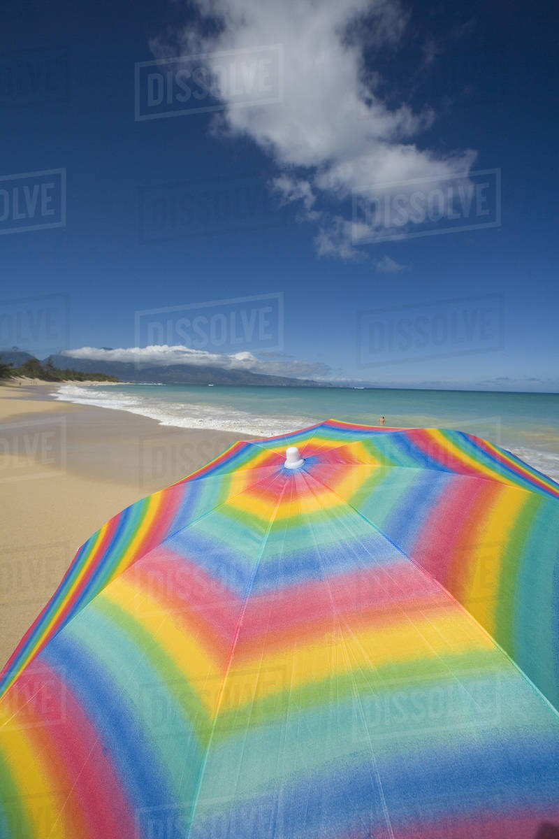 279a8c42c Brightly Colored Beach Umbrella On The Sand Near The Ocean. - Stock ...