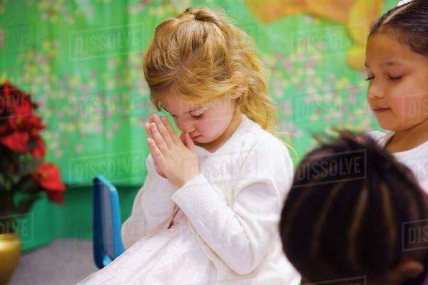A Young Girl Bowing Her Head In Prayer Royalty-free stock photo