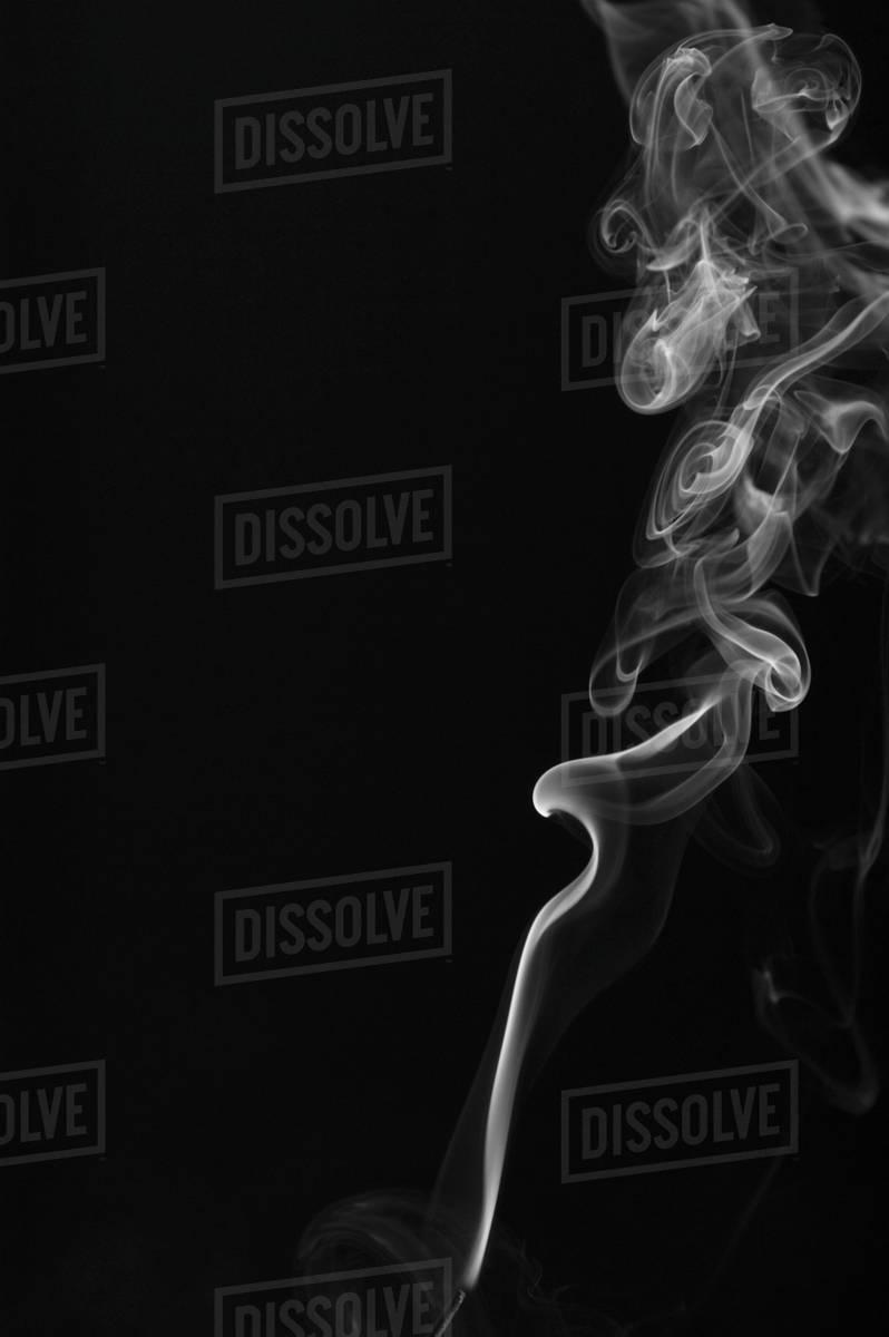 White smoke against a black background stock photo
