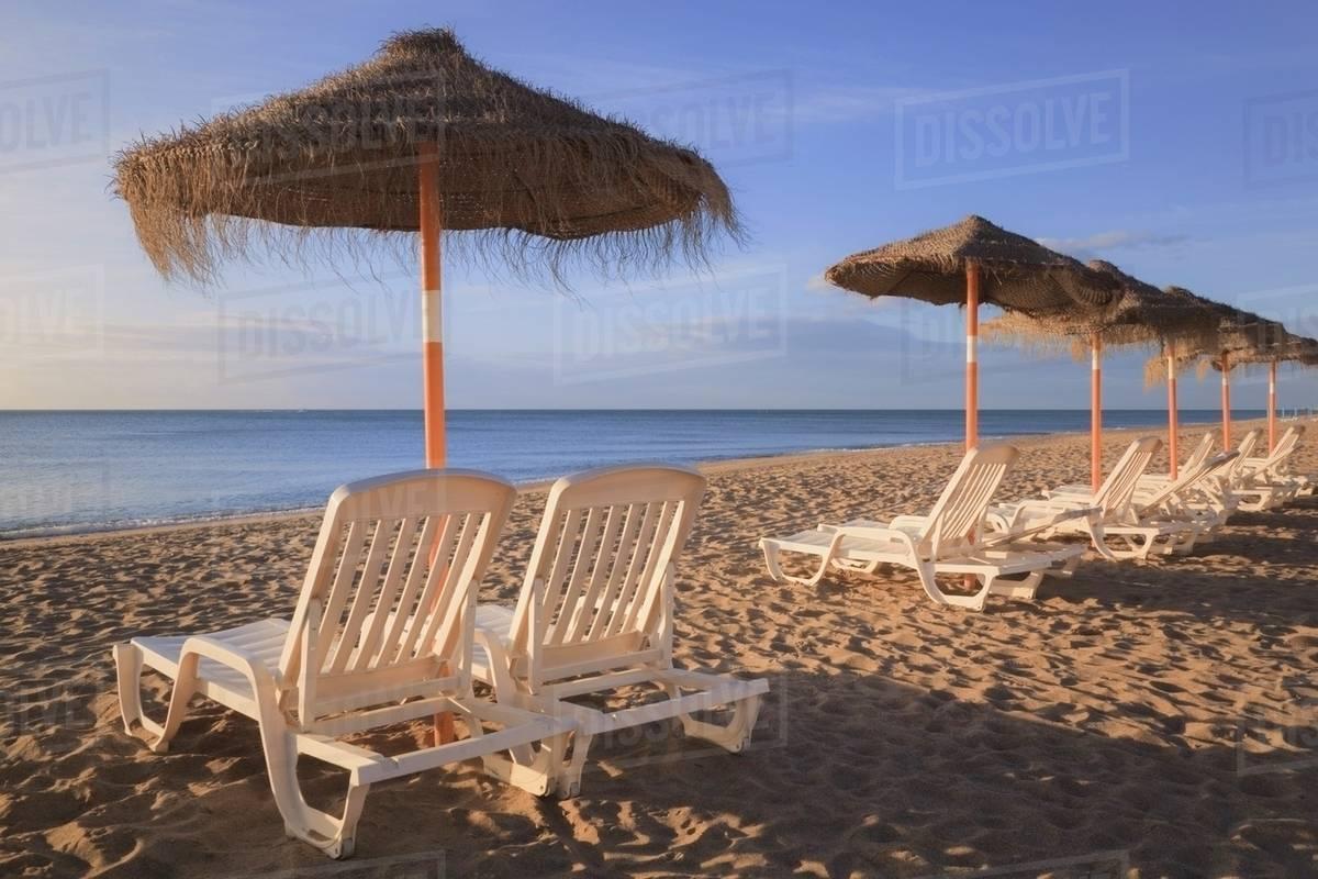 Sun Umbrellas And Beach Chairs On A In Costa Del Sol Torremolinos Malaga Andalusia Spain