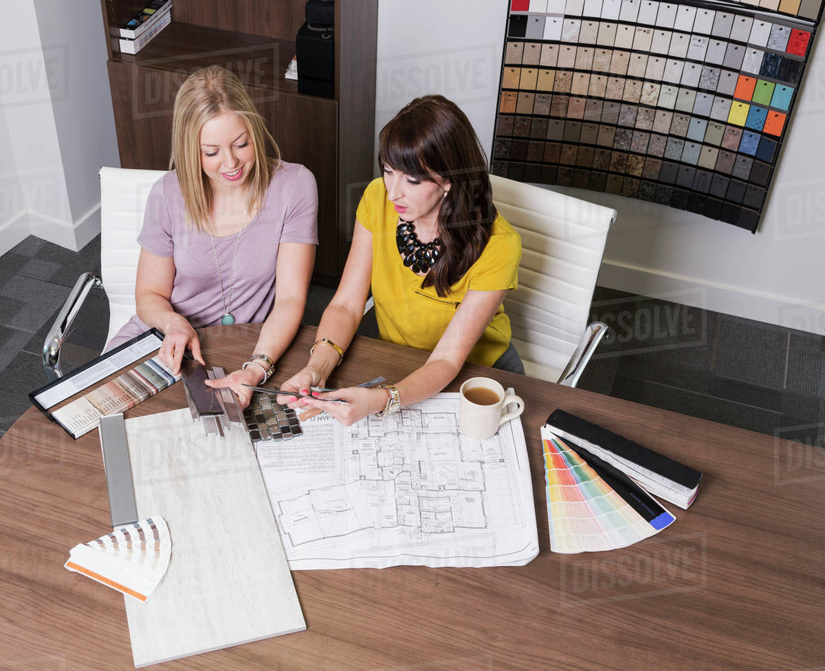 Design consultant and interior designer selecting paint and tile samples in a tile store edmonton alberta canada