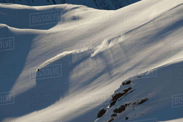 People extreme snowboarding in mountains of New Zealand Royalty-free stock photo