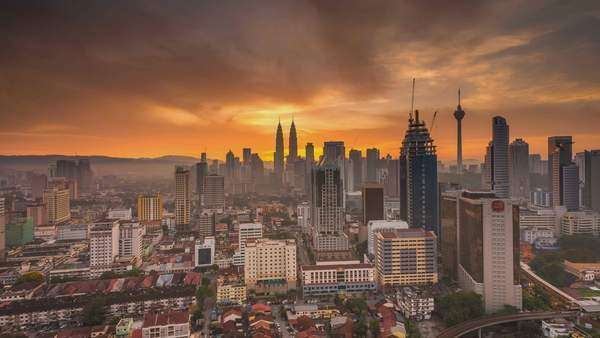 KUALA LUMPUR, MALAYSIA, 17 January 2016 - Majestic sunrise timelapse of Kuala Lumpur, high angle view with Petronas Twin Towers and KL Tower visible, pan bottom to top Royalty-free stock video