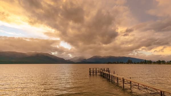 Empty Jetty By The Lake, Te Anau, Southland, New Zealand. Motion Timelapse On A Cloudy But Still Vivid Sky. Pan Right Royalty-free stock video