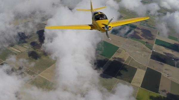 Aerial shot of an airplane flying in the clouds Royalty-free stock video