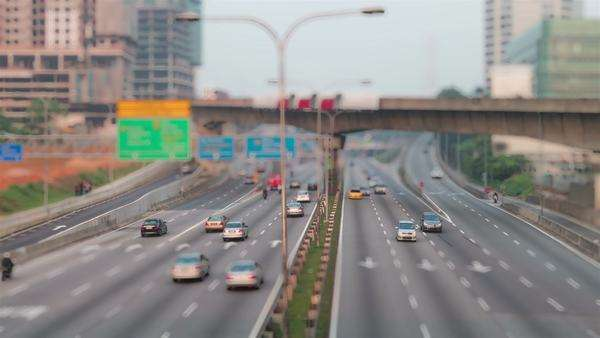 Footage of traffic timelapse. Kuala Lumpur at morning. Tilt shift effect. Royalty-free stock video