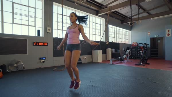 Young athletic woman working on fitness in gym with jump rope and healthy routine Royalty-free stock video