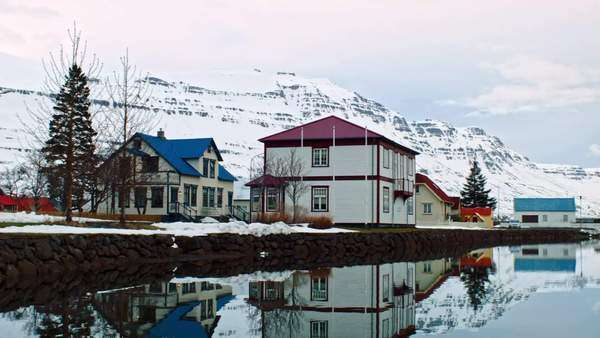 Small Icelandic town Seydisfjordur, East Iceland, winter landscape with reflection in water Royalty-free stock video
