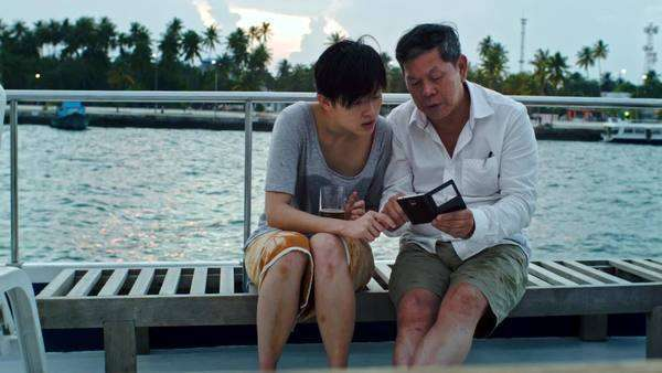 Woman teaching father how to use new smartphone mobile technology while on tropical island boat cruise holiday vacation Royalty-free stock video