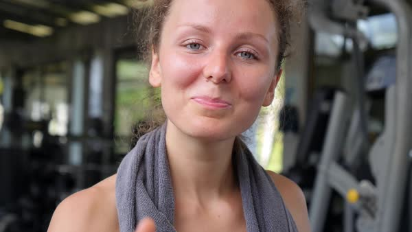 Tired sporty woman in sweat with thumbs up at fitness club Royalty-free stock video