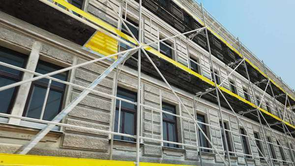 Scaffold in front of building at construction site Royalty-free stock video