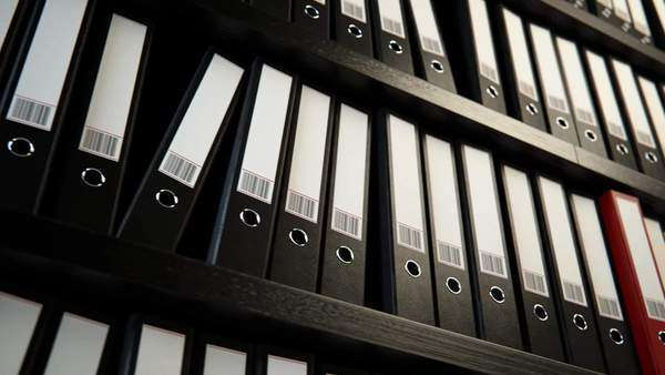 Close-up of file binders on shelf in office Royalty-free stock video