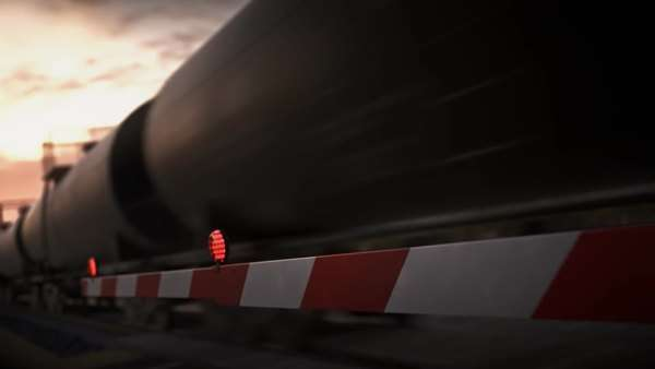 Locomotive with oil tankers passing a railway crossing Royalty-free stock video