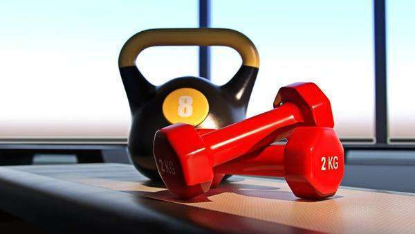 A pair of red dumbbels and kettlebell on fitness step. Royalty-free stock video