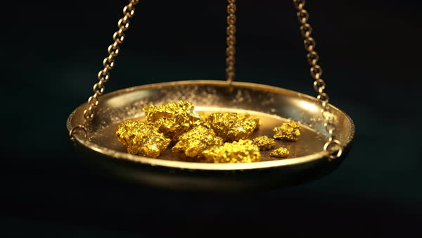 Camera zoom in on a scale with gold nuggets. Royalty-free stock video