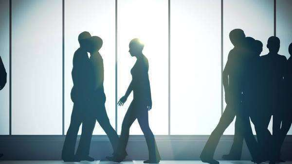 Silhouettes of a crowd of backlighted people walking in bright spacious lobby. City life. Royalty-free stock video