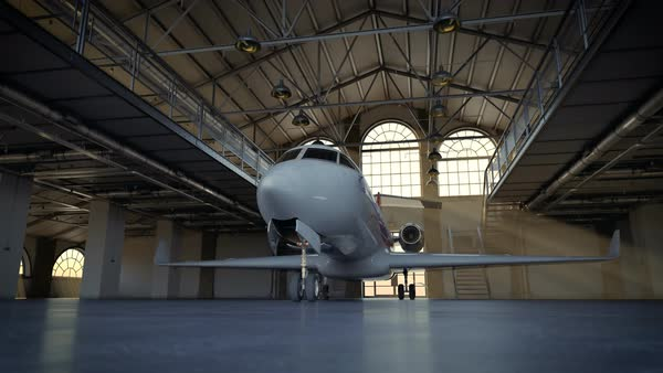 Timelapse of private jet in the loft warehouse. Lightshafts pouring through the windows. Royalty-free stock video
