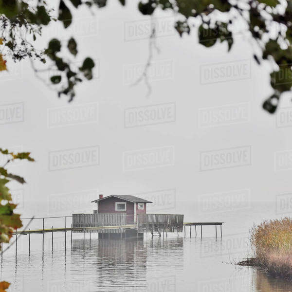 Log cabin in middle of lake Royalty-free stock photo