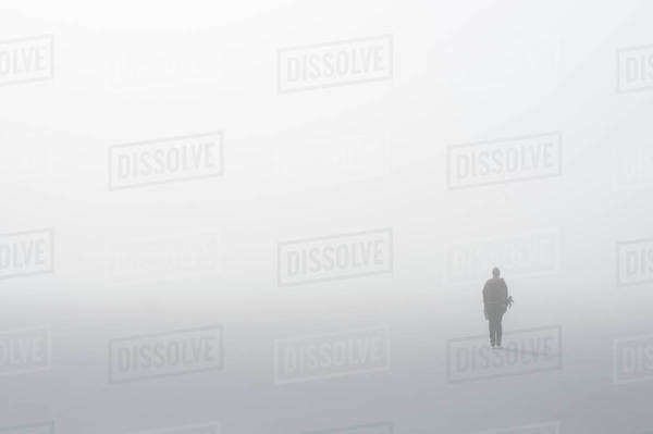 Person standing in fog on a cold winter day Royalty-free stock photo