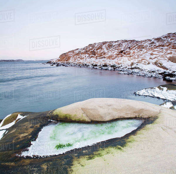 Snow covered rocks by sea during winter, West Coast, Bohuslan, Sweden Royalty-free stock photo