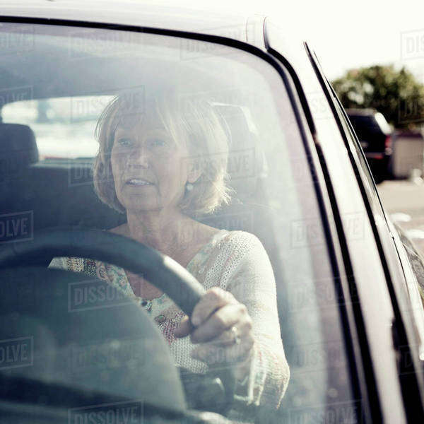 Mature woman driving car Royalty-free stock photo