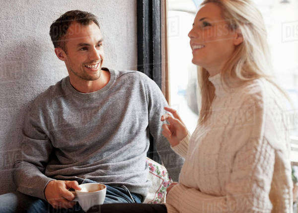 Happy young couple spending quality time at cafe Royalty-free stock photo