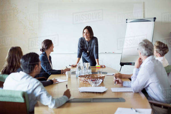 Group of business people discussing in board room Royalty-free stock photo