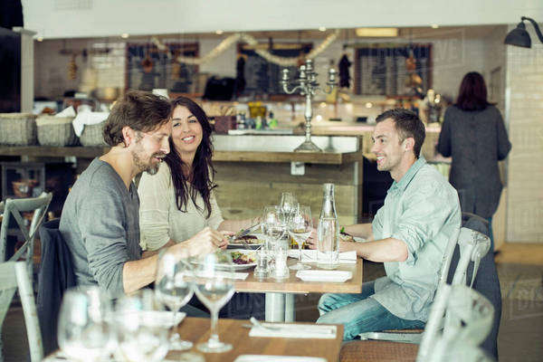 Happy friends discussing at restaurant table Royalty-free stock photo