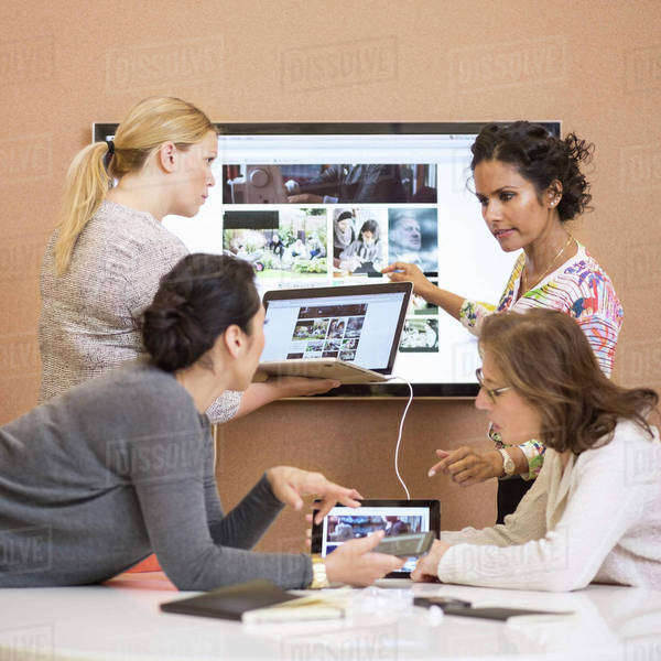 Businesswomen discussing presentation in creative office Royalty-free stock photo