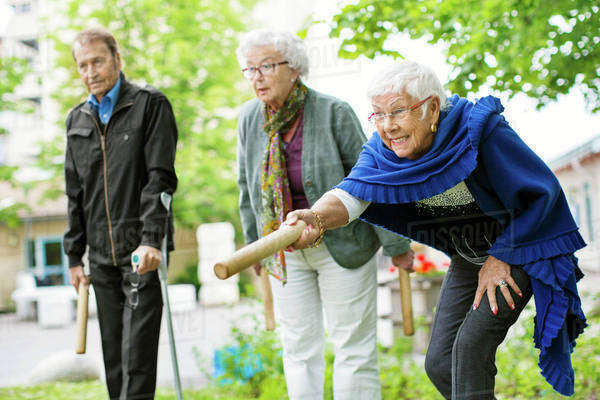 Happy senior people playing kubb game at park Royalty-free stock photo