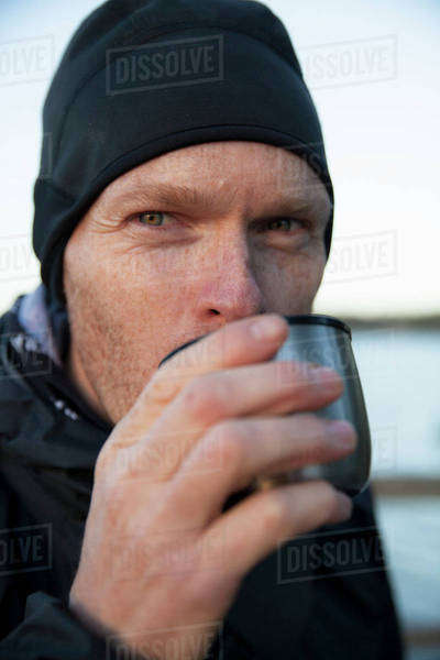 Male hiker drinking coffee outdoors Royalty-free stock photo