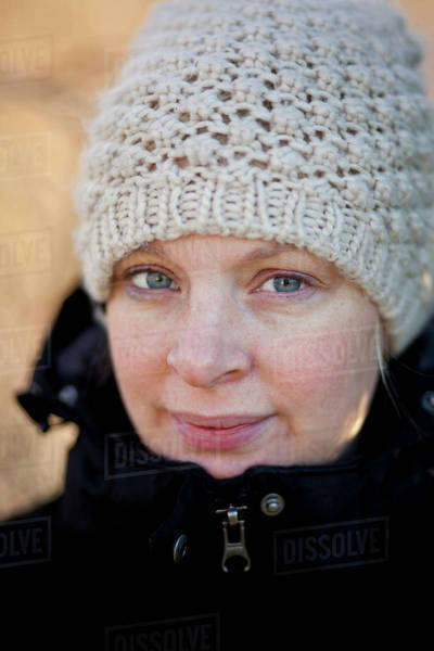 Portrait of smiling woman wearing knit hat Royalty-free stock photo