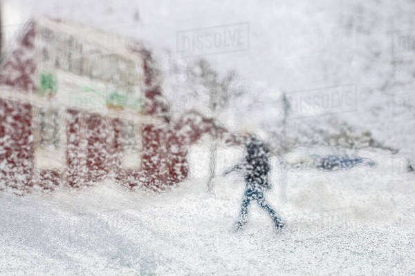 Defocused image of person walking in snowy weather Royalty-free stock photo