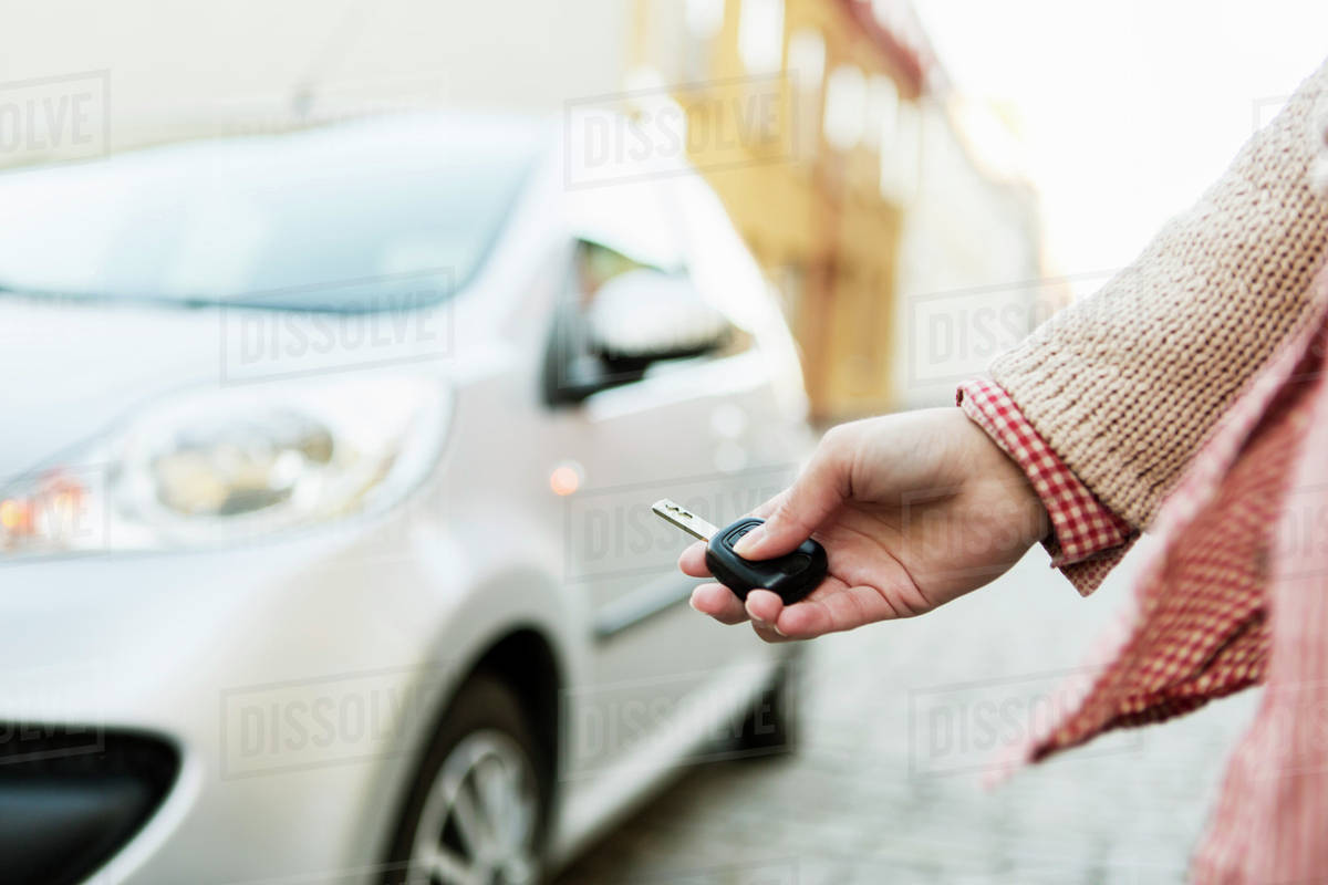 Car Remote Unlocker >> Cropped Image Of Businesswoman Using Remote Control Key To Unlock D929 25 436