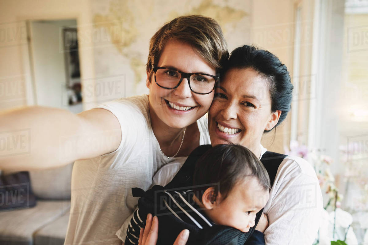 Portrait Of Smiling Lesbian Couple With Baby Girl Standing -8459