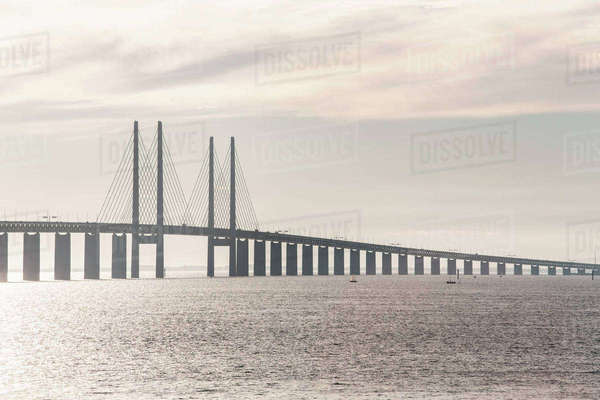 Oresund Bridge over sea against cloudy sky Royalty-free stock photo