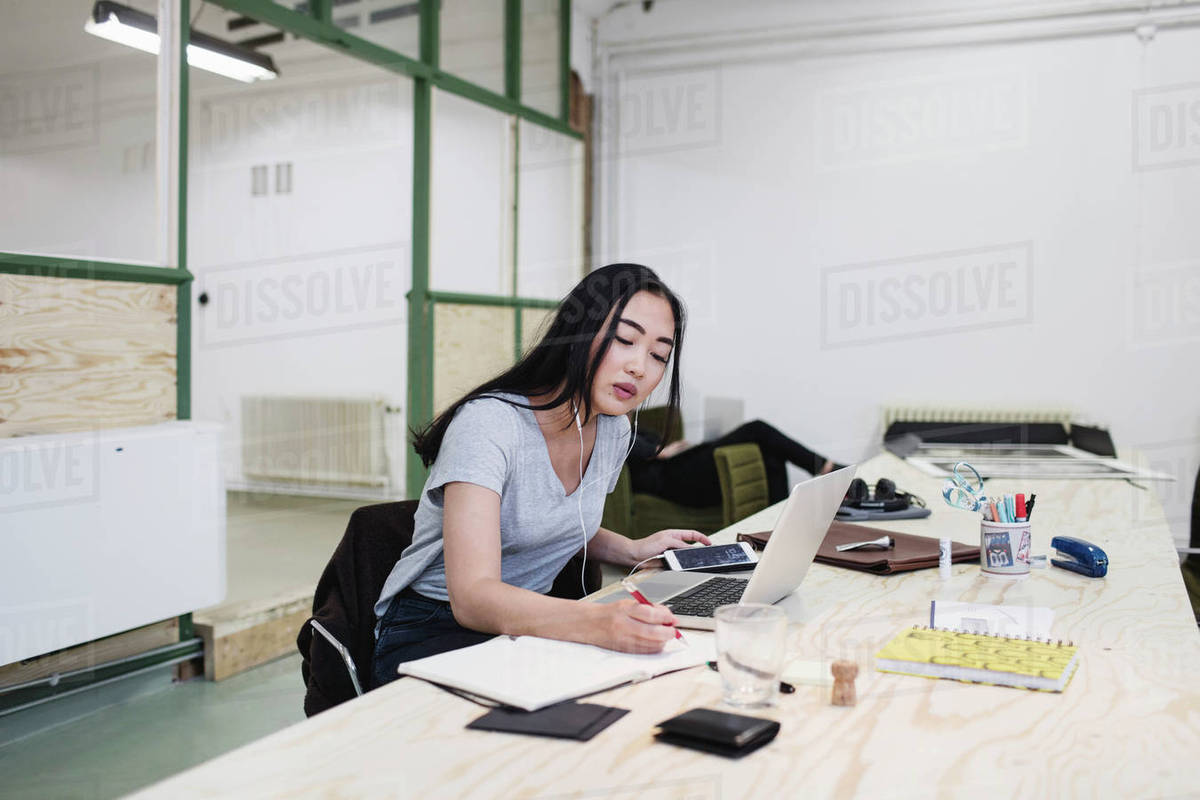 woman office furniture. Young Woman Writing While Working At Desk In Office Furniture Y