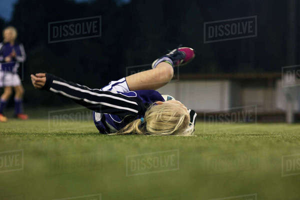 Surface level view of fallen athlete on soccer field Royalty-free stock photo