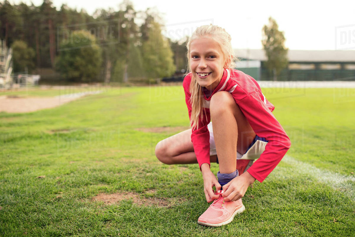 Girl Crouching On Tracks Stock Photo - Download Image Now