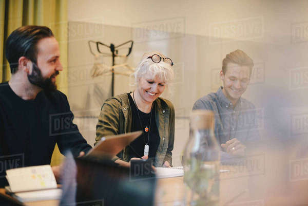 Happy colleagues working together in board room Royalty-free stock photo