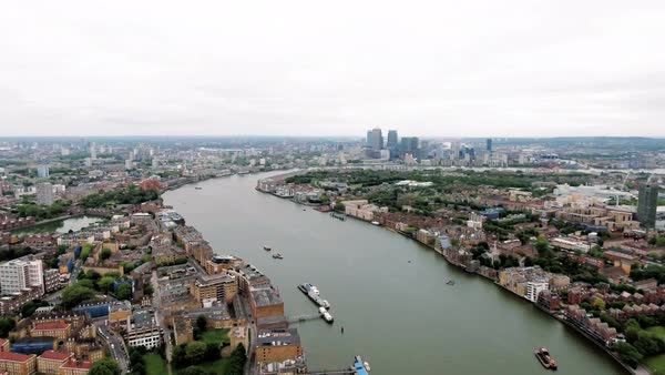 Aerial stock footage of Canary Wharf and River Thames, London England Royalty-free stock video