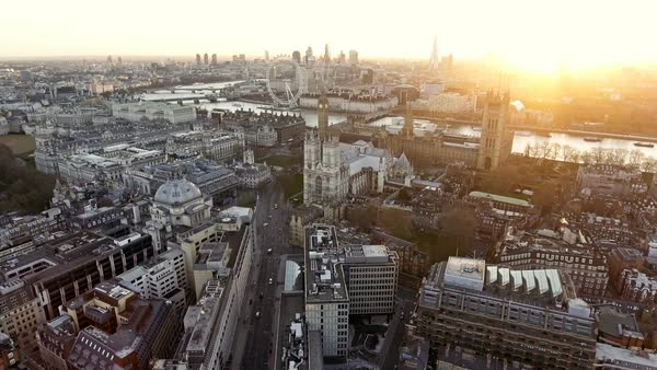Panoramic Aerial Shot of Houses of Parliament & Big Ben in Central London features The London Eye Wheel, River Thames and Iconic Business Buildings Skycrapers with Beautiful Sunrise Royalty-free stock video