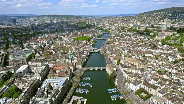 Aerial Shot over the City of Zurich in Switzerland featuring Limmat River, Bridges and Famous Landmarks Royalty-free stock video