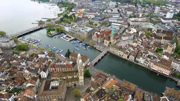 Helicopter View Aerial Video of Zurich Landmarks in City Center Town Hall Fraumünster Church, Iconic Romanesque Cathedral Royalty-free stock video