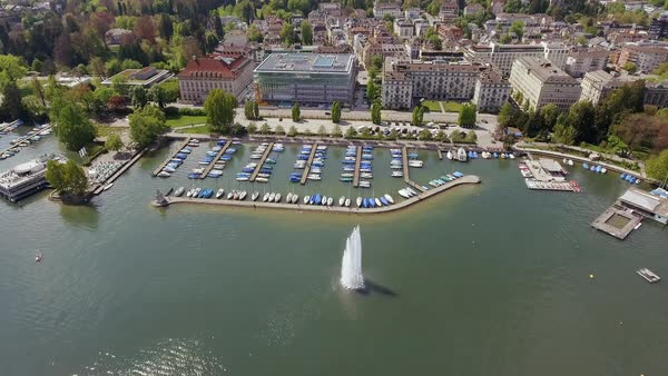 Fountain in a Sea and Luxury Marina Boats Yachts at a Port in Zurich Switzerland Aerial View Flying Over and Looking Down Royalty-free stock video