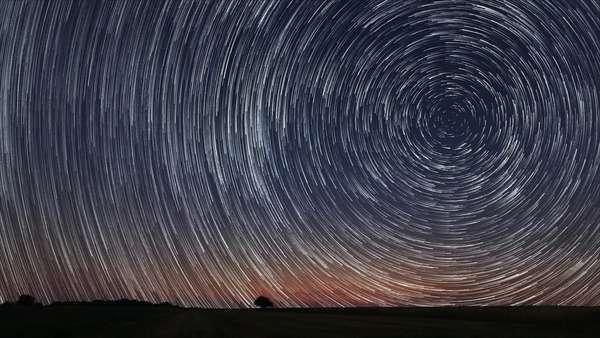 Star trails timelapse, stunning cosmos; polaris North Star at center as earth rotates on axis Royalty-free stock video