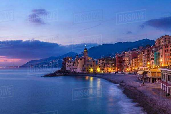 View of beach and hotels at dusk, Camogli, Liguria,  Italy Royalty-free stock photo